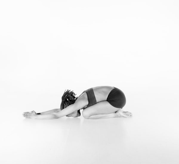 22.  Half Tortoise Pose – Ardha Kurmasana